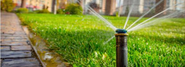 Irrigation sprinkler system watering lawn